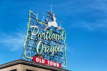 Iconic Portland, Oregon Old Town sign with an outline of Oregon and a stag